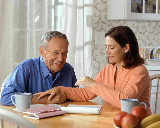 Elderly couple talking with hearing aids
